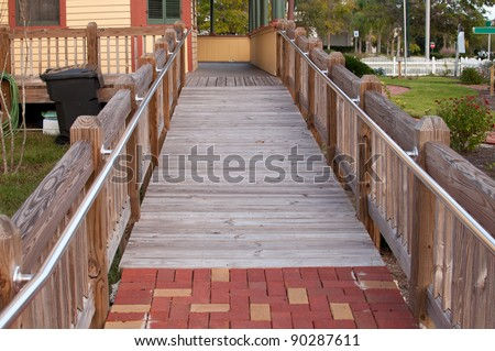 Wheelchair ramp to a house - stock photo