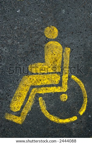 wheelchair sign painted on disabled parking space