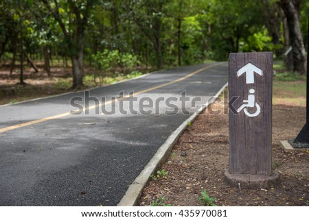 wheelchair sign road in the park - stock photo
