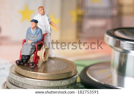wheelchair user with nursing staff and euro money with stethoscope / wheelchair user - stock photo