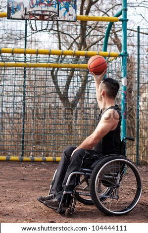 wheelchair users in sports, basketball with wheelchair, strong man - stock photo