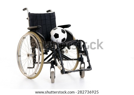 wheelchair with ball in front of white background - stock photo