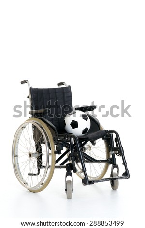 wheelchair with ball in front of white background