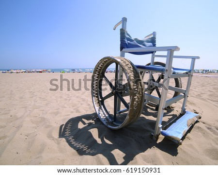 Wheelchair with stainless steel wheel rims to go in the sea and on the beach