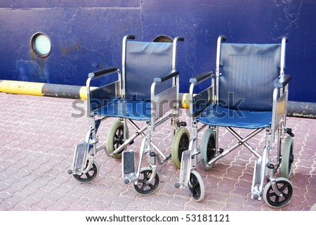 Wheelchairs, standing at the entrance to the ship - stock photo