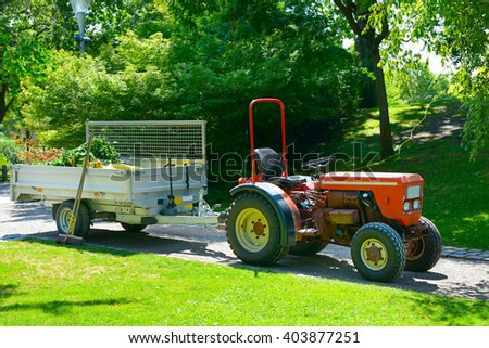 Wheeled tractor trailer in the park - stock photo
