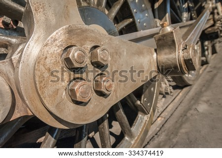 wheels and coupling rods on a vintage steam train locomotive - stock photo