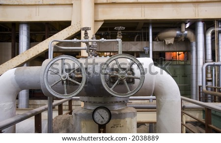 wheels and gauges inside a electrical power plant - stock photo