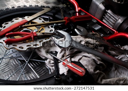 Wheels and mechanic tools - stock photo