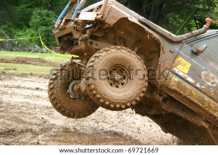 Wheels of a four wheel drive vehicle off the ground - stock photo