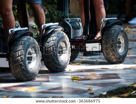 Wheels of electric scooters in the park close up - stock photo