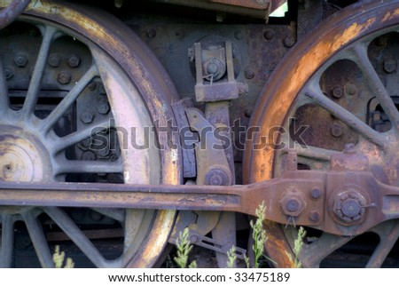wheels of old rusty steam engine - stock photo