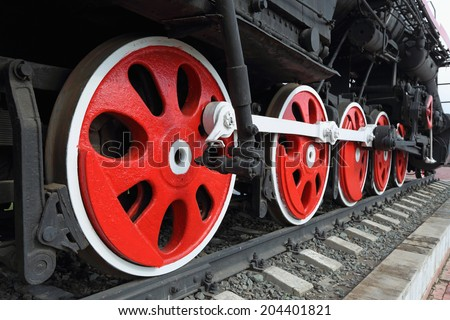 Wheels of the ancient engine close up - stock photo