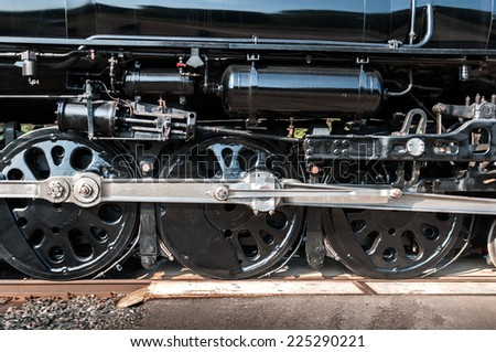 Wheels of Vintage Steam Engine Move By - motion blur - stock photo