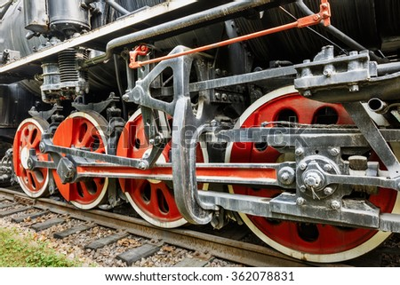 Wheels of vintage steam train - stock photo