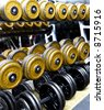 wheights, dumbells in the gym - stock photo