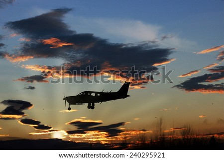 When an engine airplane in the sky sunset - stock photo