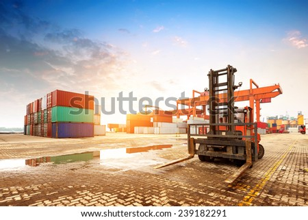 When the container terminal at dusk, work cranes and forklift.