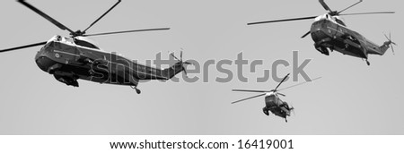 When the president of the United States is due to travel by Marine One, three helicopters will stand ready. - stock photo