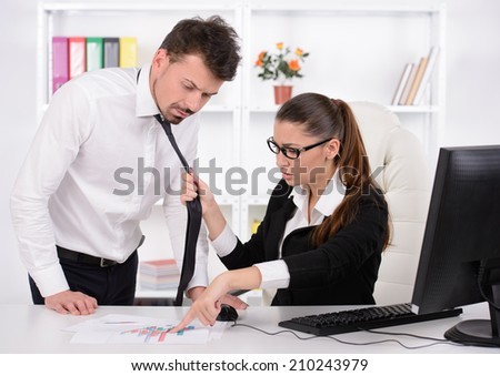 Where is the report? Stressed young business woman shouting at his secretary while sitting at his working place - stock photo