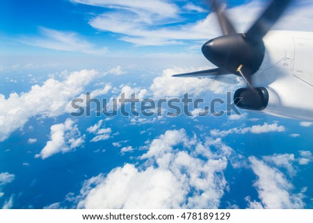 Where land meets sea, aerial view with a plane in focus