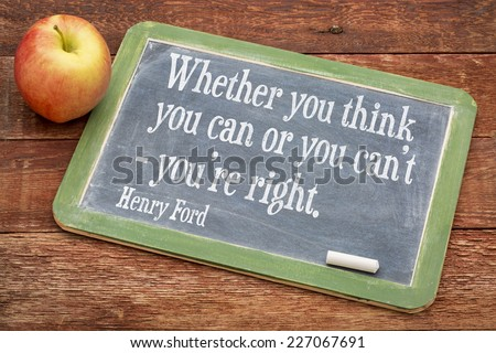 Whether you think you can or you can't - you're right, motivational quote by Henry Ford on a slate blackboard against red barn wood - stock photo