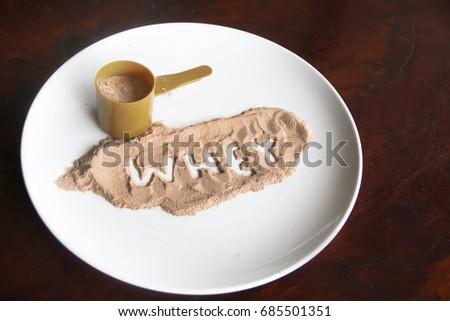 stock-photo-whey-protein-scoop-on-white-