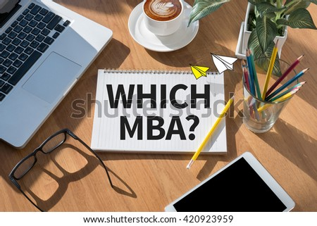 WHICH MBA? open book on table and coffee Business - stock photo