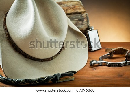 whip,spurs and hat, on wood - stock photo