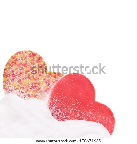 whipped cream and two chocolate hearts of multicolored isolated on white background - stock photo