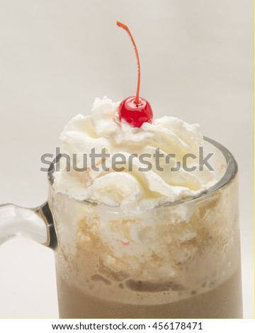 Whipped cream cherry ice cream and root beer in a mug.Delicious Soda Float/Refreshing beverage ready to be enjoyed - stock photo