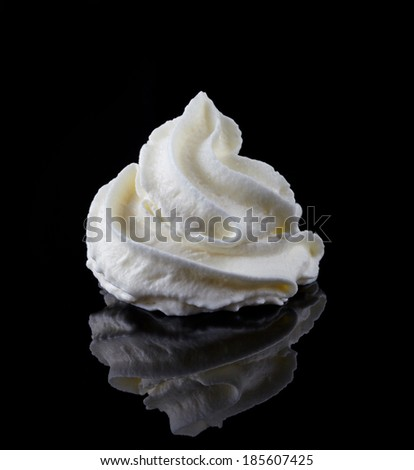 whipped cream on a black background - stock photo
