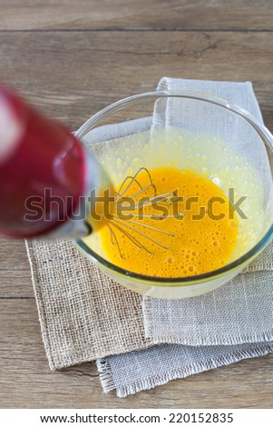 Whipping eggs - stock photo