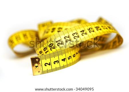 Whirled yellow tape measure - stock photo