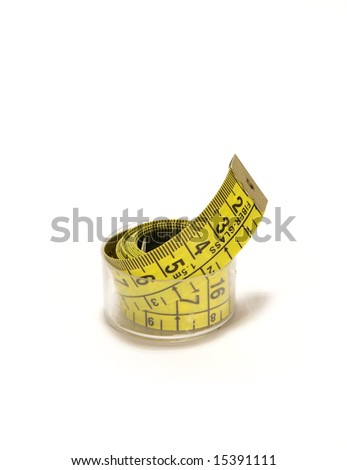 Whirled yellow tape measure isolated on white
