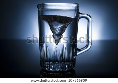 whirlpool in a pitcher of water - stock photo