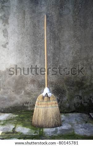 whisk broom over a grunge background