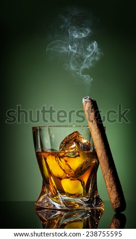 Whiskey and cigar on a green background - stock photo