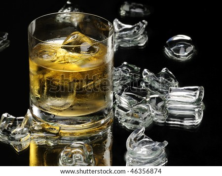 Whiskey and ice cubes - stock photo