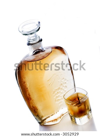 Whiskey bottle and whiskey glass - stock photo