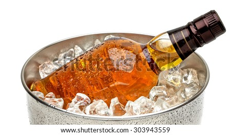 Whiskey bottle in ice bucket with crushed ice on white background including clipping path - stock photo