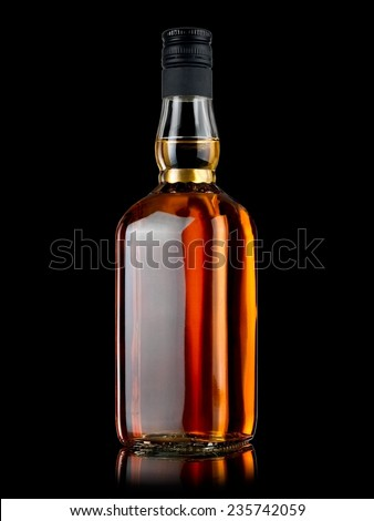 Whiskey bottle on black background - stock photo