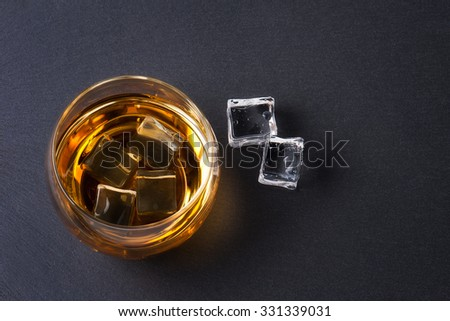 Whiskey Bourbon in a Glass with Ice - stock photo