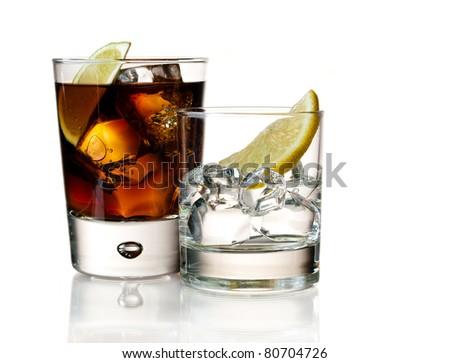 Whiskey cola and vodka lemon on white - stock photo