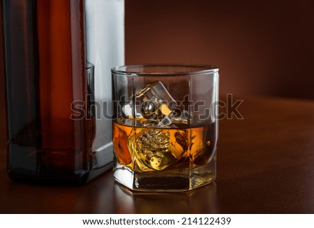 Whiskey, dark background - stock photo