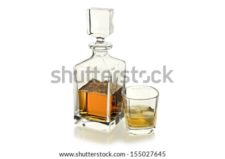 whiskey decanter and glass isolated on white - stock photo