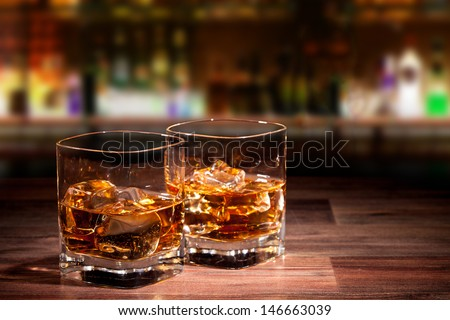 Whiskey drinks on wood - stock photo
