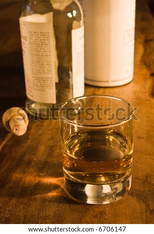 whiskey glass and bottle - stock photo