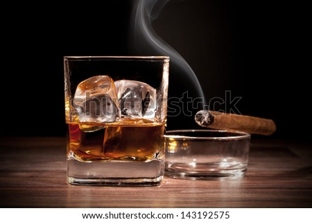 Whiskey glass with cigar - stock photo