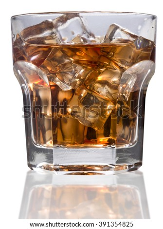 whiskey glass with ice cubes close-up rocks on white background.Selective focus.